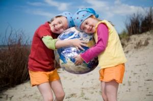 kids_two_girls_holding_earth_beach_ball